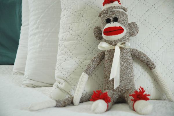 sock-monkey-on-bed